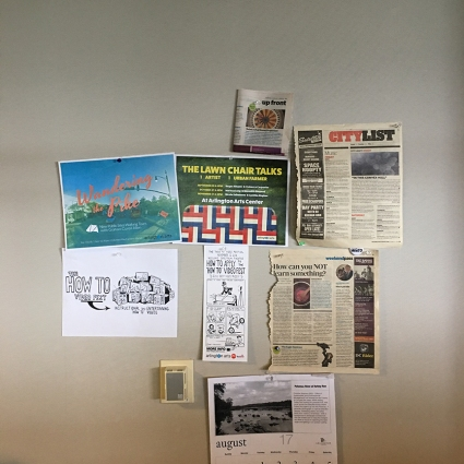 Arlington Office Wall of Programs & Press