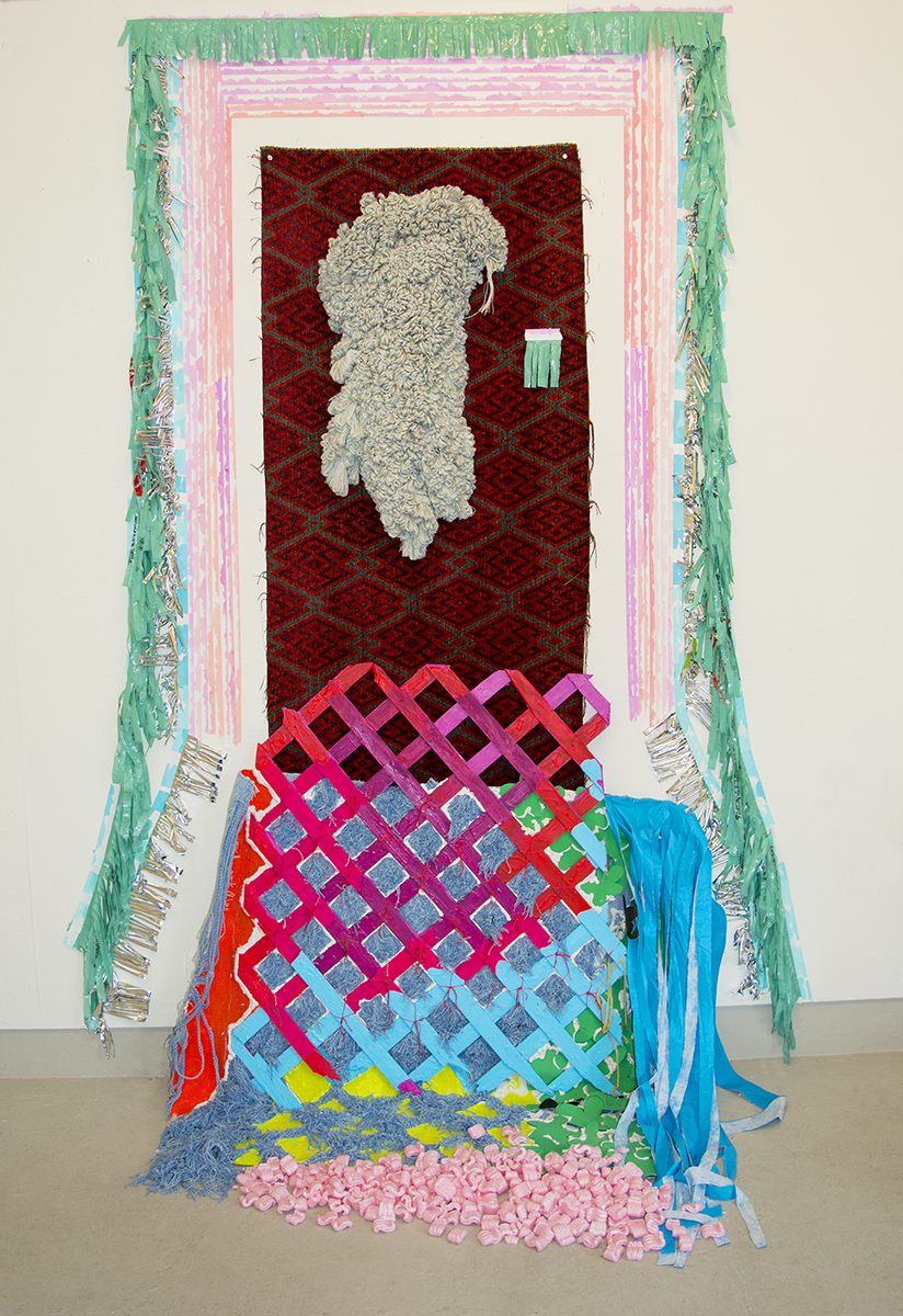 Peterson_Lauren_Golden jump at gut candy_Acrylic on fencing and tape, fabric, upholstery fringe, balloon foil, packing peanuts, found plastic, thread, caulk_9x5x2ft_2019